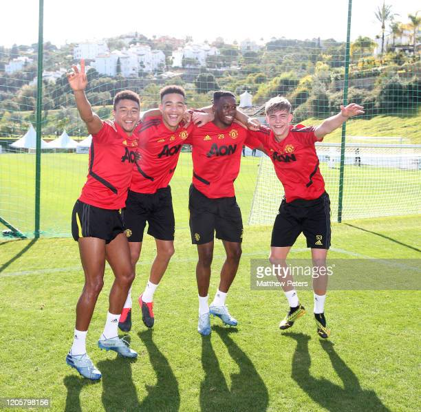 Jesse Lingard, Mason Greenwood, Aaron Wan-Bissaka and Brandon Williams of Manchester United in action during a first team training session on...