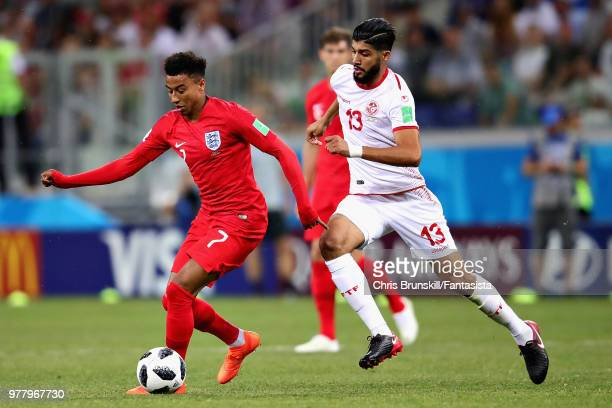 Jesse Lingard of England and Ferjani Sassi of Tunisia in action during the 2018 FIFA World Cup Russia group G match between Tunisia and England at...