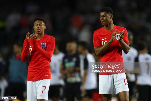 Jesse Lingard of England and Marcus Rashford of England applaud the fans during the International Friendly match between England and Costa Rica at...