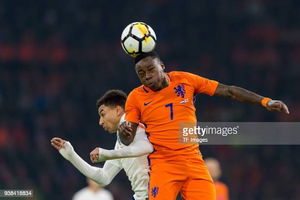Jesse Lingard of England and Quincy Promes of Netherlands battle for the ball during the international friendly match between Netherlands and England...