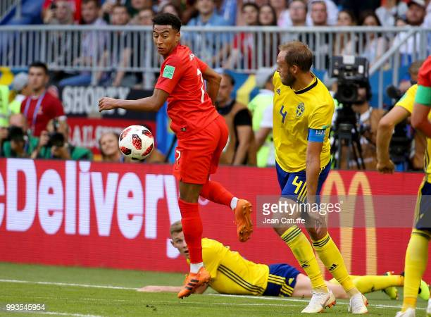 Jesse Lingard of England Andreas Granqvist of Sweden during the 2018 FIFA World Cup Russia Quarter Final match between Sweden and England at Samara...