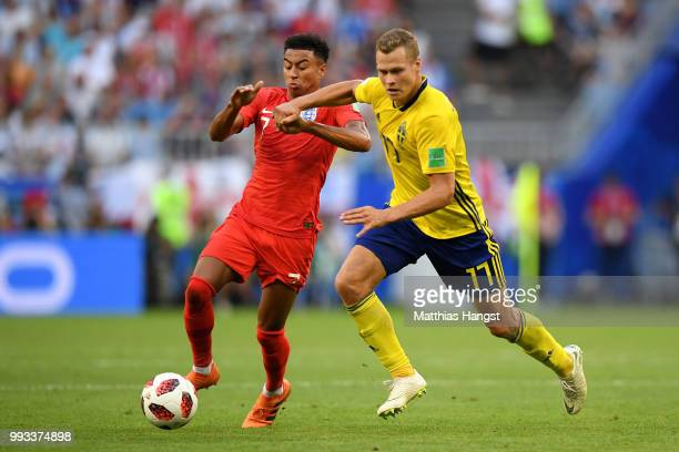 Jesse Lingard of England battles for possession with Viktor Claesson of Sweden during the 2018 FIFA World Cup Russia Quarter Final match between...