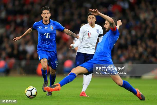 Jesse Lingard of England battles with Lorenzo Pellegrini of Italy during the international friendly match between England and Italy at Wembley...