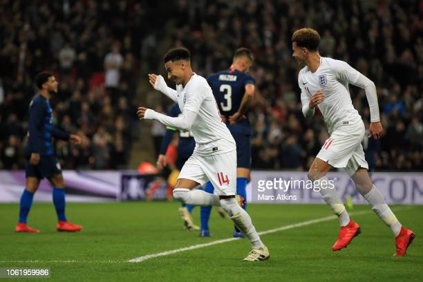 Jesse Lingard of England celebrates scoring their 1st goal with Dele Alli during the International Friendly match between England and United States...