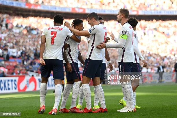 Jesse Lingard of England celebrates with Conor Coady after scoring their team's first goal during the 2022 FIFA World Cup Qualifier match between...