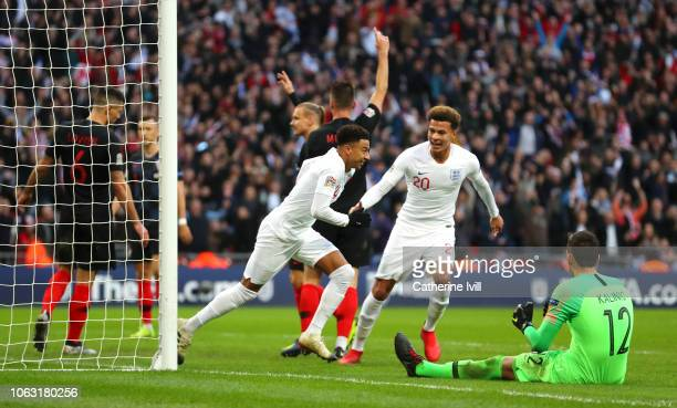Jesse Lingard of England celebrates with teammate Dele Alli after scoring his team's first goal during the UEFA Nations League A group four match...