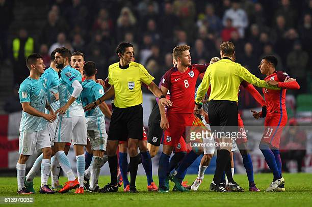 Jesse Lingard of England is held back by teammates during the FIFA 2018 World Cup Qualifier Group F match between Slovenia and England at Stadion...