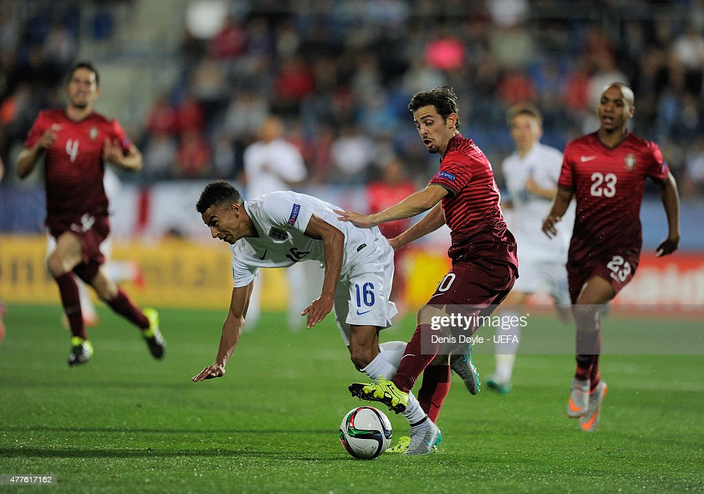 Jesse Lingard of England is tackled by Bernardo Silva of Portugal during the UEFA Under21 European Championship 2015 match between England and Portugal at Mestsky Fotbalovy Stadium on June 18, 2015 in Uherske Hradiste, Czech Republic.