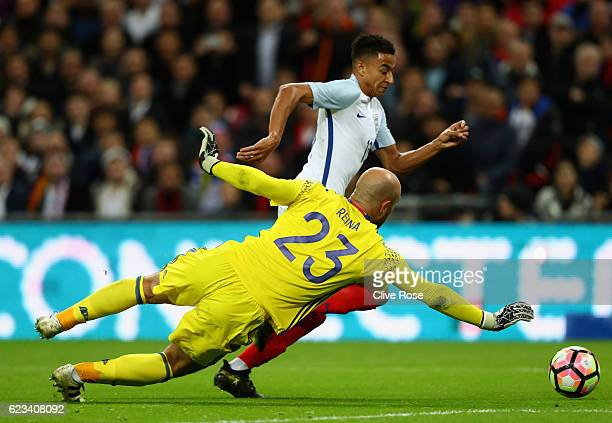 Jesse Lingard of England takes on goalkeeper Pepe Reina of Spain during the international friendly match between England and Spain at Wembley Stadium...