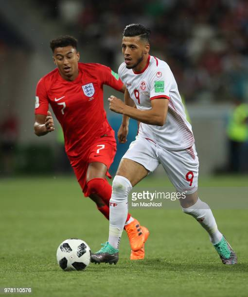 Jesse Lingard of England vies with Anice Badri of Tunisia during the 2018 FIFA World Cup Russia group G match between Tunisia and England at...