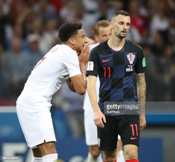 Jesse Lingard of England with Marcelo Brozovic of Croatia react during the 2018 FIFA World Cup Russia Semi Final match between England and Croatia at...