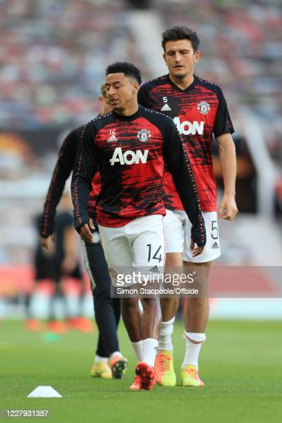 Jesse Lingard of Man Utd and Harry Maguire of Man Utd warm up before the UEFA Europa League round of 16 second leg match between Manchester United...