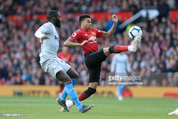 Jesse Lingard of Man Utd battles with Arthur Masuaku of West Ham during the Premier League match between Manchester United and West Ham United at Old...