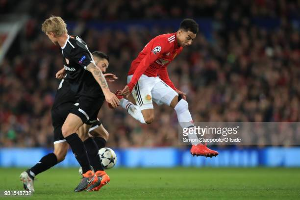 Jesse Lingard of Man Utd in action with Pablo Sarabia and Simon Kjaer of Sevilla during the UEFA Champions League Round of 16 Second Leg match...