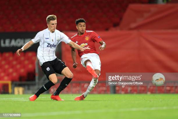 Jesse Lingard of Man Utd scores their 1st goal in spite of the efforts of Philipp Wiesinger of LASK during the UEFA Europa League round of 16 second...
