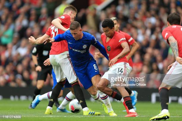 Jesse Lingard of Man Utd tackles Ross Barkley of Chelsea during the Premier League match between Manchester United and Chelsea at Old Trafford on...