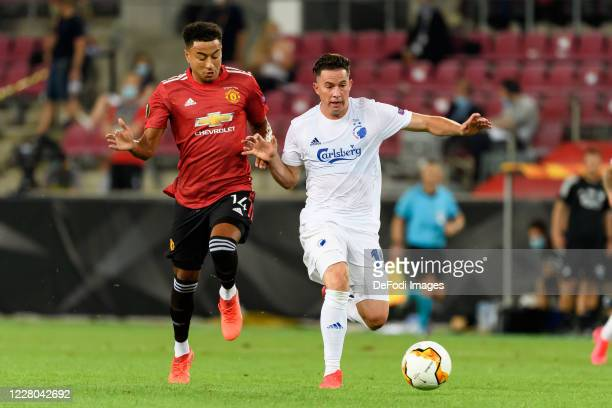 Jesse Lingard of Manchester United and Bryan Oviedo of FC Kopenhagen battle for the ball during the UEFA Europa League Quarter Final between...