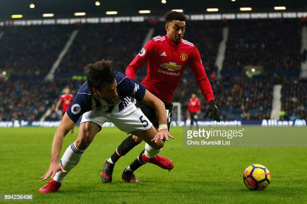 Jesse Lingard of Manchester United and Claudio Yacob of West Bromwich Albion in action during the Premier League match between West Bromwich Albion...