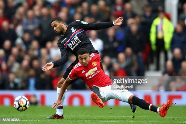 Jesse Lingard of Manchester United and Jairo Riedewald of Crystal Palace compete for the ball during the Premier League match between Manchester...