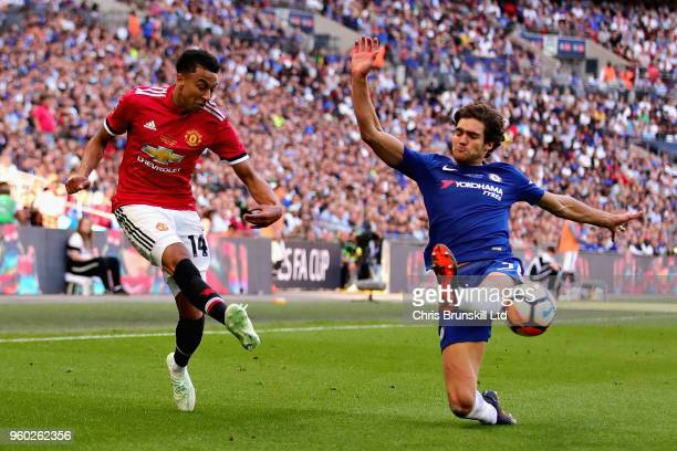 Jesse Lingard of Manchester United and Marcos Alonso of Chelsea in action during the Emirates FA Cup Final between Chelsea and Manchester United at...
