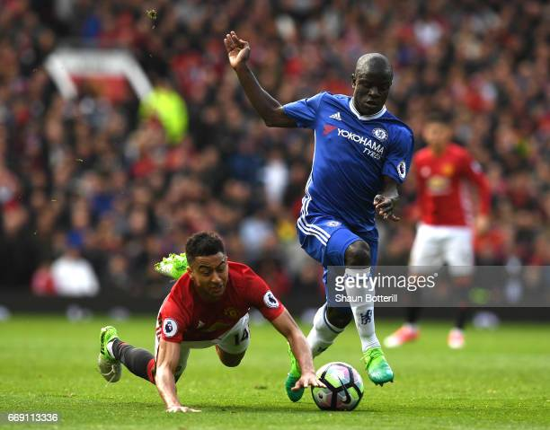 Jesse Lingard of Manchester United and N'Golo Kante of Chelsea battle for possession during the Premier League match between Manchester United and...