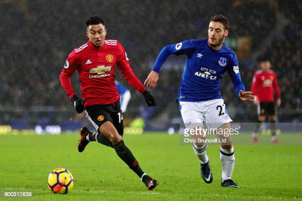 Jesse Lingard of Manchester United and Nikola Vlasic of Everton in action during the Premier League match between Everton and Manchester United at...