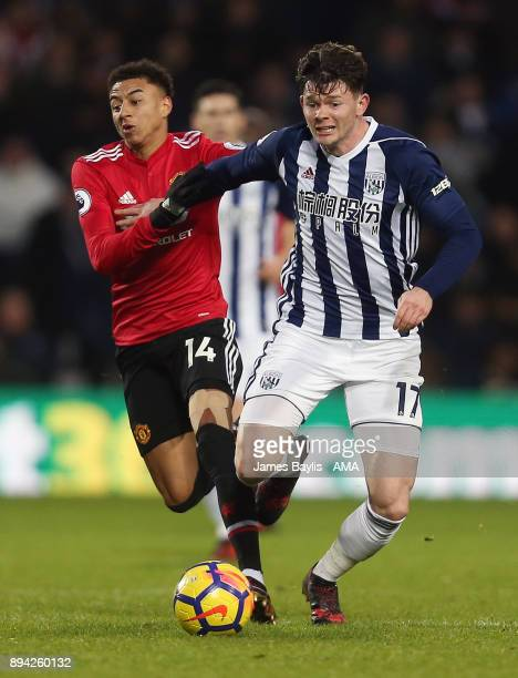 Jesse Lingard of Manchester United and Oliver Burke of West Bromwich Albion during the Premier League match between West Bromwich Albion and...