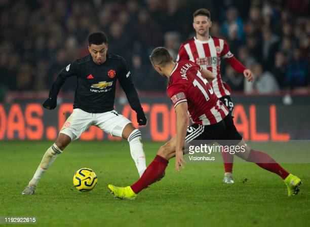 Jesse Lingard of Manchester United and Phil Jagielka of Sheffield United in action during the Premier League match between Sheffield United and...