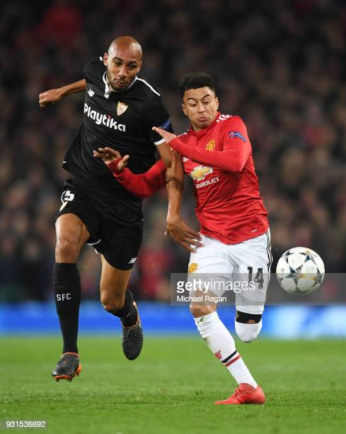 Jesse Lingard of Manchester United and Steven N'Zonzi of Sevilla battle for the ball during the UEFA Champions League Round of 16 Second Leg match...