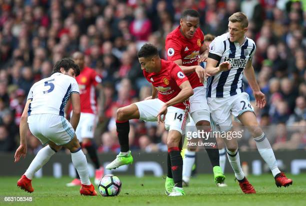 Jesse Lingard of Manchester United attempts to get away from Claudio Yacob of West Bromwich Albion during the Premier League match between Manchester...
