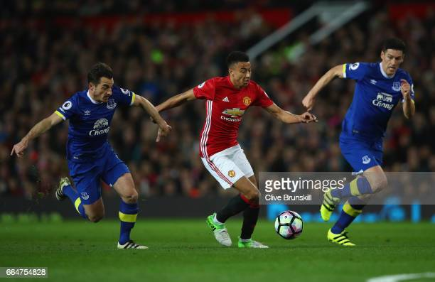 Jesse Lingard of Manchester United attempts to get past Leighton Baines of Everton during the Premier League match between Manchester United and...