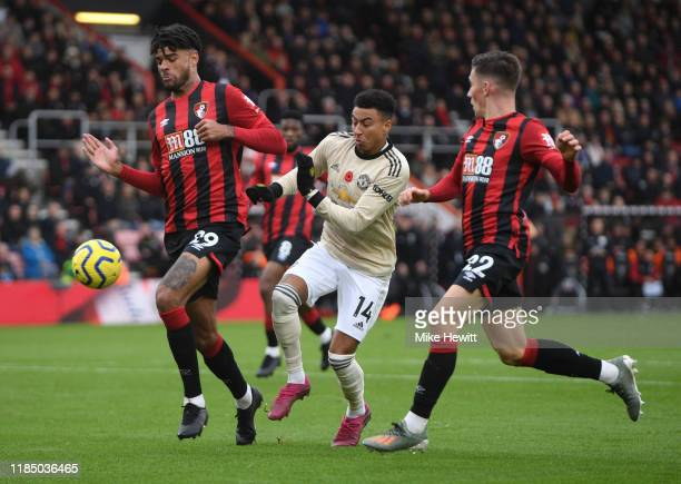 Jesse Lingard of Manchester United battles for possession with Philip Billing of AFC Bournemouth during the Premier League match between AFC...