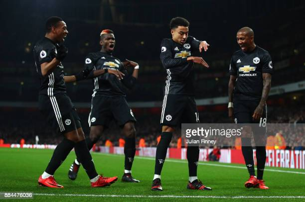 Jesse Lingard of Manchester United celebrates after scoring his sides second goal with his Manchester United team mates during the Premier League...