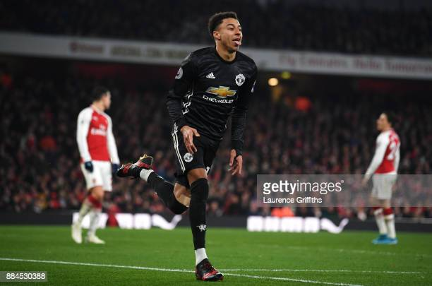Jesse Lingard of Manchester United celebrates after scoring his sides third goal during the Premier League match between Arsenal and Manchester...