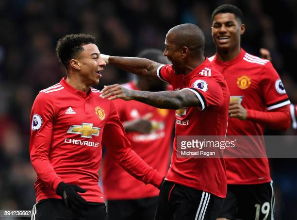 Jesse Lingard of Manchester United celebrates after scoring his sides second goal with teammate Ashley Young during the Premier League match between...