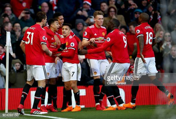 Jesse Lingard of Manchester United celebrates after scoring his sides second goal with team mates during the Premier League match between Manchester...