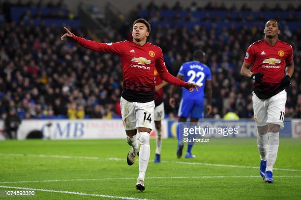Jesse Lingard of Manchester United celebrates after scoring his team's fourth goal during the Premier League match between Cardiff City and...