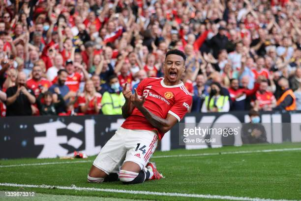 Jesse Lingard of Manchester United celebrates after scoring their side's fourth goal during the Premier League match between Manchester United and...
