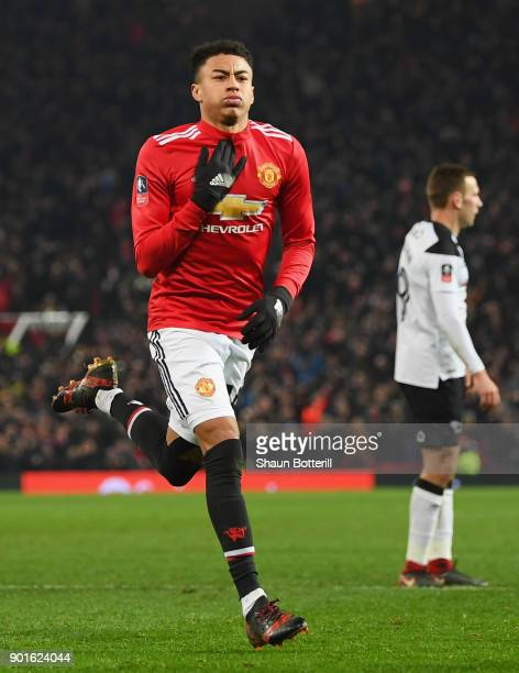Jesse Lingard of Manchester United celebrates as he scores their first goal during the Emirates FA Cup Third Round match between Manchester United...
