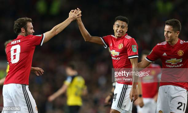 Jesse Lingard of Manchester United celebrates his part in Ben Turner of Burton Albion scoring an own goal during the Carabao Cup Third Round match...