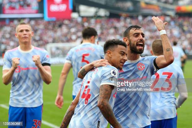 Jesse Lingard of Manchester United celebrates scoring his side's second goal with team mate Bruno Fernandes during the Premier League match between...