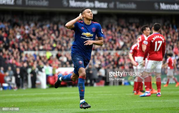 Jesse Lingard of Manchester United celebrates scoring his sides second goal during the Premier League match between Middlesbrough and Manchester...
