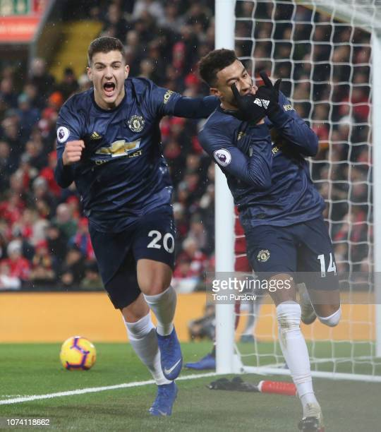 Jesse Lingard of Manchester United celebrates scoring their first goal during the Premier League match between Liverpool FC and Manchester United at...