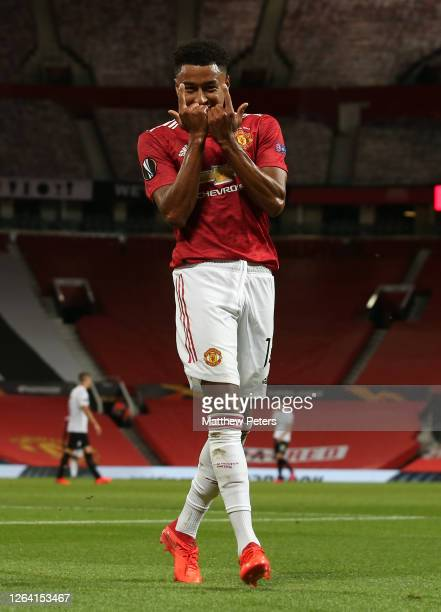 Jesse Lingard of Manchester United celebrates scoring their first goal during the UEFA Europa League round of 16 second leg match between Manchester...