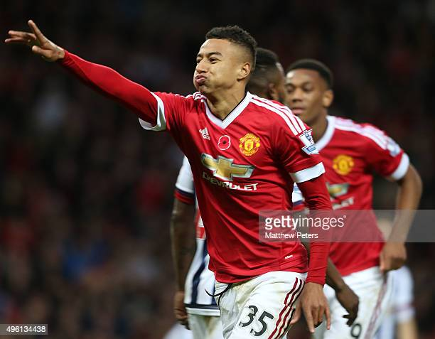 Jesse Lingard of Manchester United celebrates scoring their first goaln during the Barclays Premier League match between Manchester United and West...