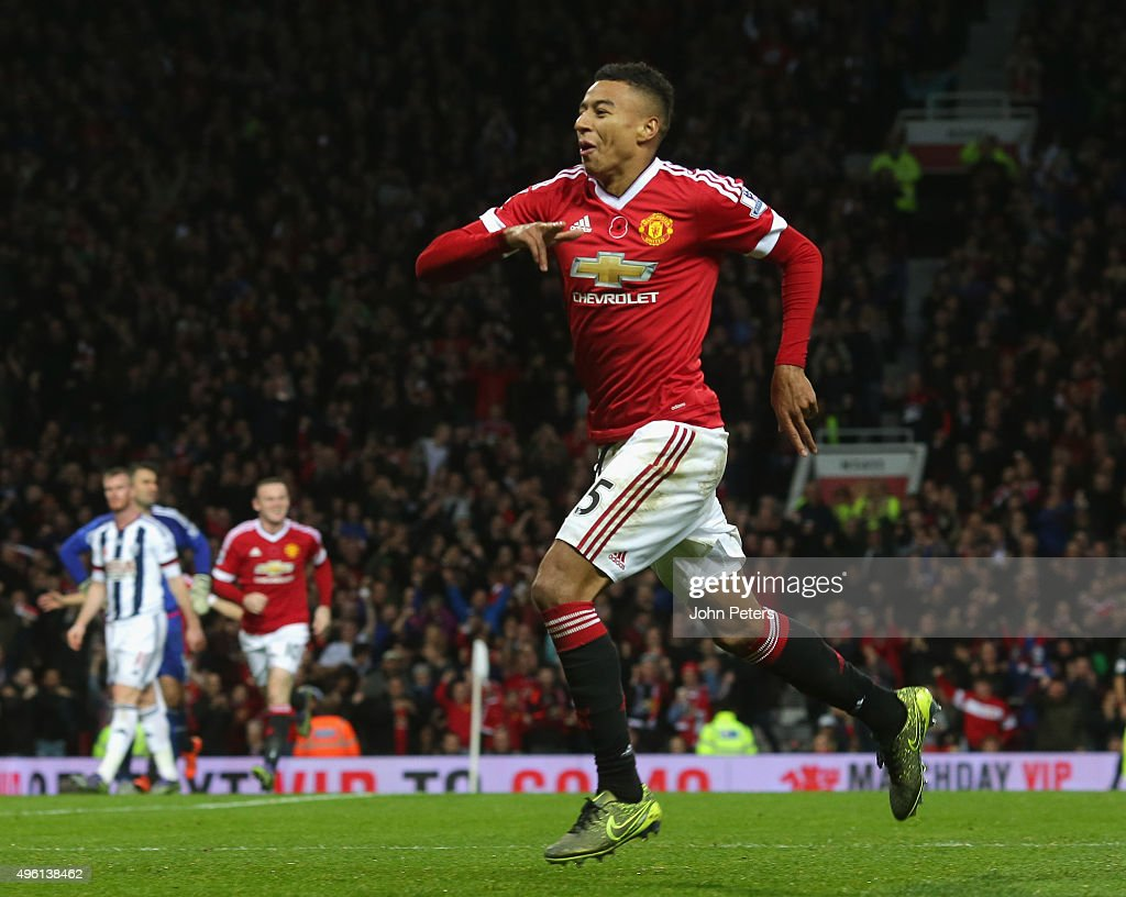 Jesse Lingard of Manchester United celebrates scoring their first goal during the Barclays Premier League match between Manchester United and West Bromwich Albion at Old Trafford on November 7, 2015 in Manchester, England.