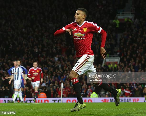 Jesse Lingard of Manchester United celebrates scoring their first goal during the Barclays Premier League match between Manchester United and West...