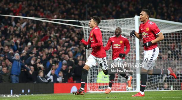 Jesse Lingard of Manchester United celebrates scoring their first goal during the Emirates FA Cup Third Round match between Manchester United and...