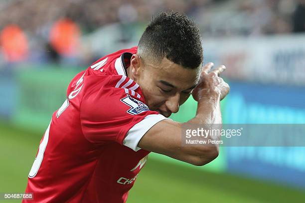 Jesse Lingard of Manchester United celebrates scoring their second goal during the Barclays Premier League match between Newcastle United and...
