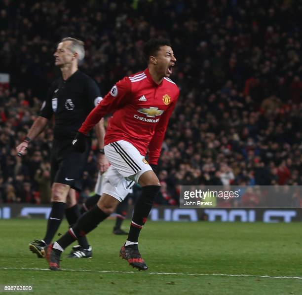 Jesse Lingard of Manchester United celebrates scoring their second goal during the Premier League match between Manchester United and Burnley at Old...